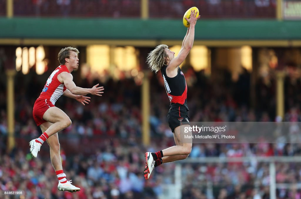 Dyson Heppell of the Bombers marks the ball ahead of Callum Mills of the Swans during the AFL Second Elimination Final match between the Sydney Swans and the Essendon Bombers at Sydney Cricket Ground on September 9, 2017 in Sydney, Australia.