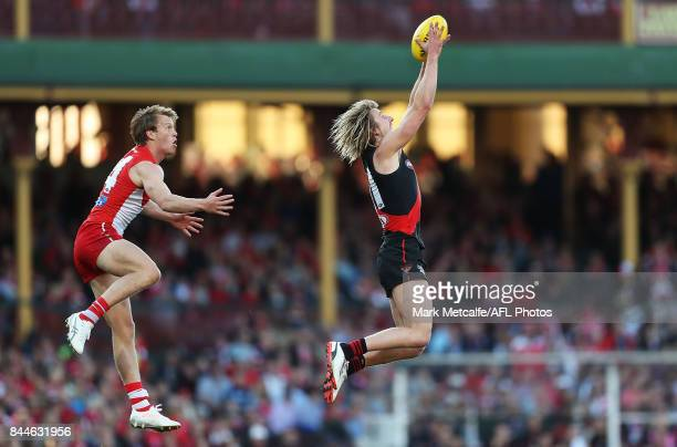 Dyson Heppell of the Bombers marks the ball ahead of Callum Mills of the Swans during the AFL Second Elimination Final match between the Sydney Swans...