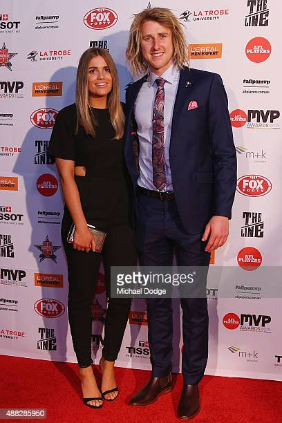 Dyson Heppell of the Bombers poses with partner Kate Turner during the announcement of the AFLPA MVP at Shed 14 Central Pier on September 15 2015 in...