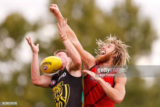Dyson Heppell of the Bombers spoils the ball during the JLT Community Series AFL match between the Essendon Bombers and the Richmond Tigers at Norm...