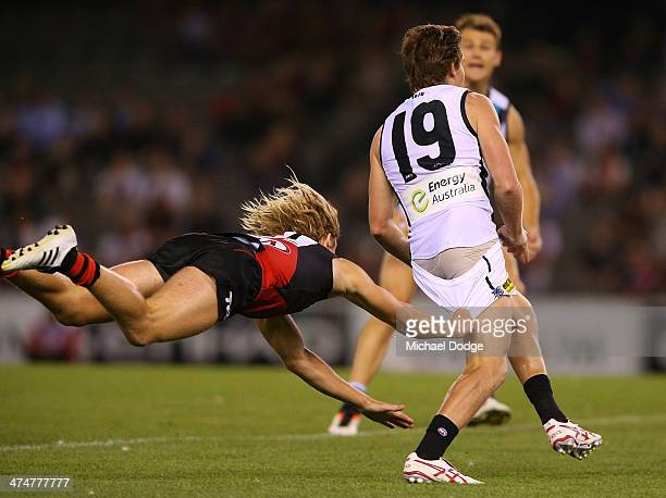 Dyson Heppell of the Bombers tackles Matt White of the Power during the round three AFL NAB Challenge match between the Essendon Bombers and the Port...