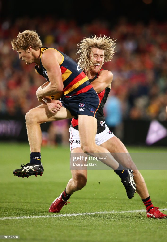 Dyson Heppell of the Bombers tackles Rory Sloane of the Crows during the round four AFL match between the Adelaide Crows and the Essendon Bombers at Adelaide Oval on April 15, 2017 in Adelaide, Australia.