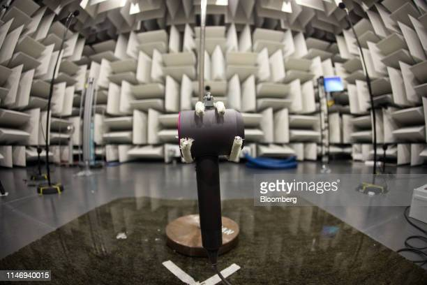 A Dyson supersonic hairdryer is held in a clamp in the semi anechoic acoustics chamber at the Dyson Group Plc campus in Malmesbury UK on Wednesday...