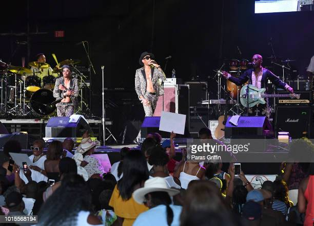 Dyson Tate Frank Stickemz and Dwayne Wiggins of 'Tony Toni Tone' performs onstage during KISS 1041 FM Flashback Festival at Cellairis Amphitheatre at...