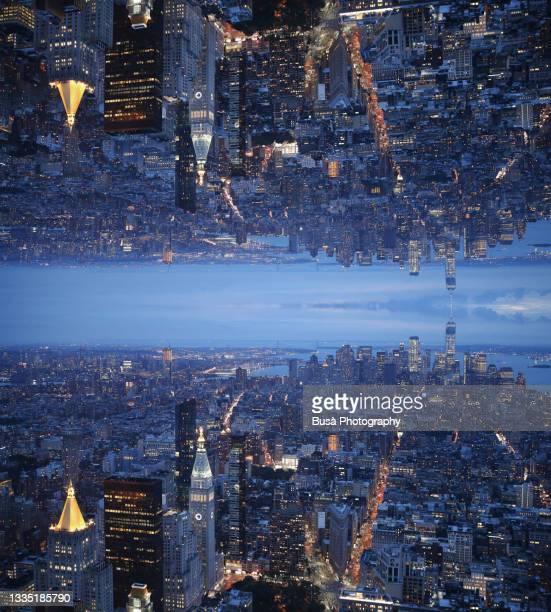 dystopian future, capsized reflected image of horizon at twilight over lower manhattan in new york city, usa - wonder película de 2017 fotografías e imágenes de stock