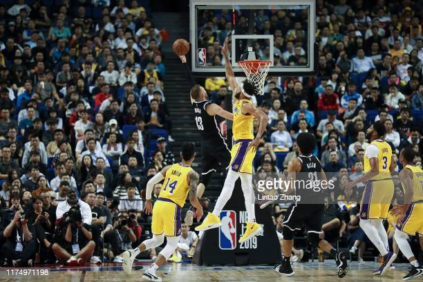 Dzanan Musa of of the Brooklyn Nets in action against JaVale McGee of the Los Angeles Lakers during a preseason game as part of 2019 NBA Global Games...