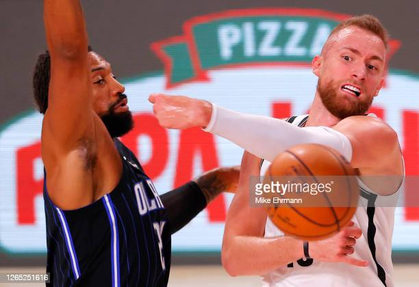 Dzanan Musa of the Brooklyn Nets passes the ball against Khem Birch of the Orlando Magic during the first half at AdventHealth Arena at ESPN Wide...