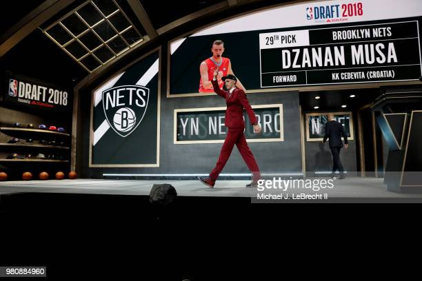 Dzanan Musa waves to the crowd after being selected twentyninth by the Brooklyn Nets on June 21 2018 at Barclays Center during the 2018 NBA Draft in...