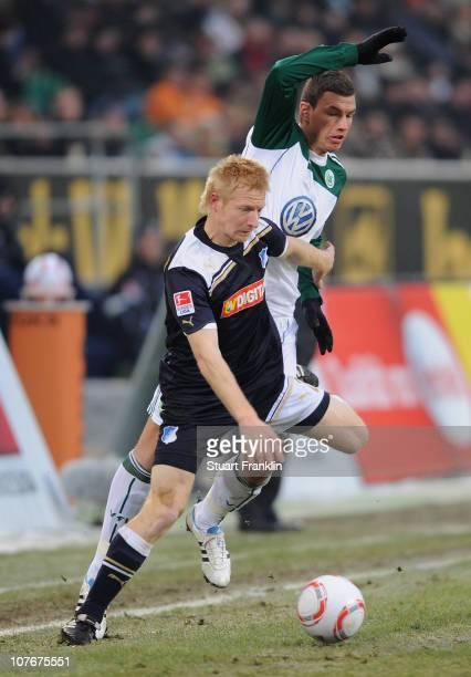 Dzeko of Wolfsburg is challenged by Andreas Iberberger of Hoffenheim during the Bundesliga match between VfL Wolfsburg and 1899 Hoffenheim at...