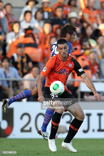 Dzenan Radoncic of Shimizu SPulse and Koki Mizuno of Ventforet Kofu compete for the ball during the JLeague match between Shimizu SPulse and...