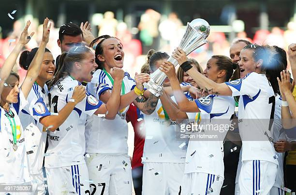 Dzenifer Maroszan AnaMaria Crnogorecevic Peggy Kuznik Fatmire Alushi and Simone Laudehr of Frankfurt celebrate winning with the trophy after the...