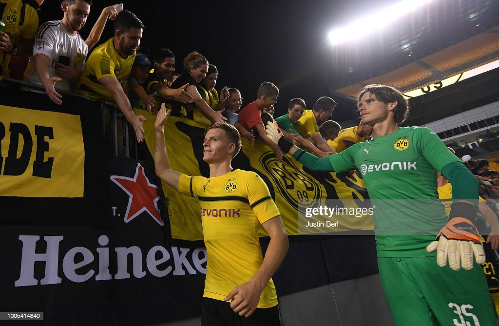 Dzenis Burnic #32 and Marwin Hitz #35 of Borussia Dortmund acknowledge the fans at the conclusion of a 2-2 (4-3 on Penalty Kicks) win by Benfica during the 2018 International Champions Cup match at Heinz Field on July 25, 2018 in Pittsburgh, Pennsylvania.