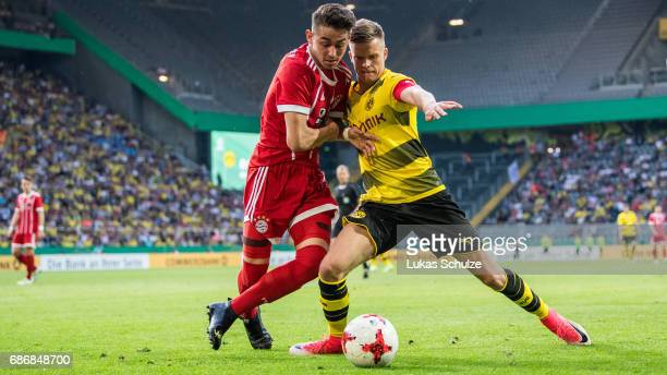 Dzenis Burnic of Dortmund and Meritan Shabani of Munich fight for the ball during the U19 German Championship Final between Borussia Dortmund and FC...