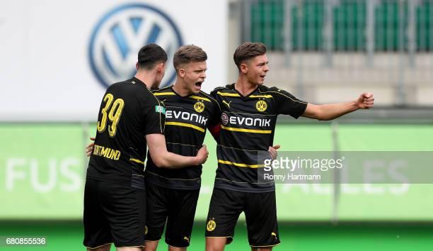 Dzenis Burnic of Dortmund celebrates after scoring his team's third goal with JanniLuca Serra and Alexander Laukart of Dortmund during the AJuniors...