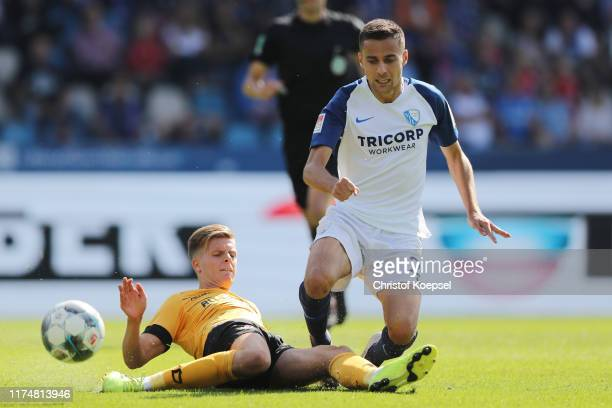 Dzenis Burnic of Dresden challenges Cristian Gamboa of Bochum during the Second Bundesliga match between VfL Bochum 1848 and SG Dynamo Dresden at...