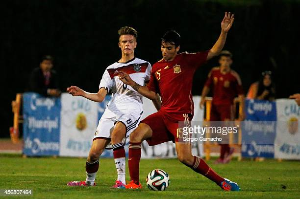 Dzenis Burnic of Germany challenges Jose Alejandro Martin Valeron of Spain during the international friendly match between U17 Spain and U17 Germany...