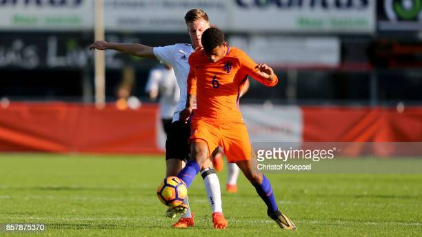 Dzenis Burnic of Germany challenges Juninho Bacuna of the Netherlands during the International friendly match between U20 Netherlands and U20 Germany...