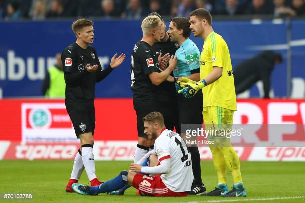 Dzenis Burnic of Stuttgart argues with referee Guido Winkelmann after he received a red card following a foul at Aaron Hunt of Hamburg during the...