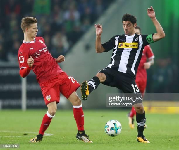 Dzenis Burnic of Stuttgart fights for the ball with Lars Stindl of Moenchengladbach during the Bundesliga match between Borussia Moenchengladbach and...