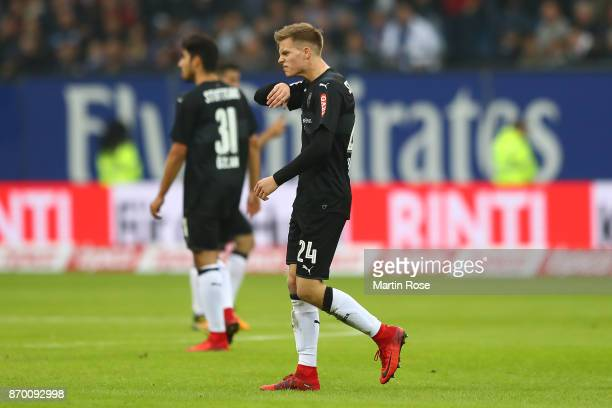 Dzenis Burnic of Stuttgart leaves the pitch following a red card during the Bundesliga match between Hamburger SV and VfB Stuttgart at...