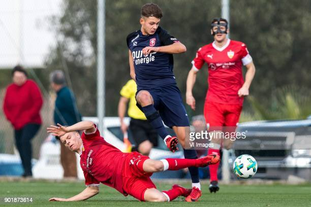 Dzenis Burnic of VFB Stuttgart Alexander Laukart of FC Twente during the friendly match between FC Twente and VFB Stuttgart at the La Manga Club...