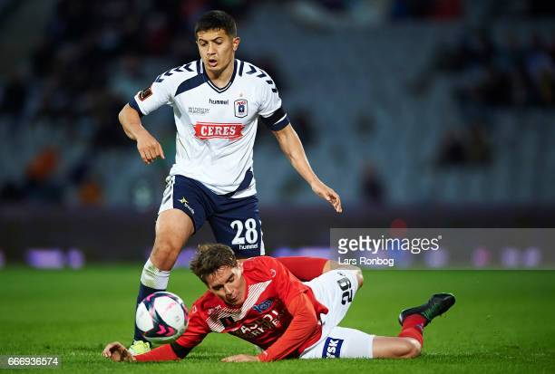 Dzhamaldin Khodzhaniazov of AGF Aarhus and Robert Skov of Silkeborg IF compete for the ball during the Danish Alka Superliga match between AGF Aarhus...