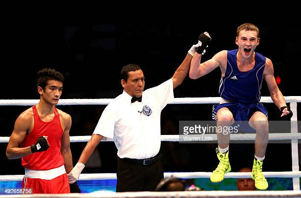 Dzmitry Asanau of Belarus jumps for joy after beating Shiva Thapa of India after final of the Men's Bantam Weight during the AIBA World Boxing...