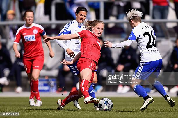 Dzsenifer Maroszan and Jessica Fishlock of 1 FFC Frankfurt challenge Tabea Kemme of Turbine Potsdam during the Women's DFB Cup Semi Final match...