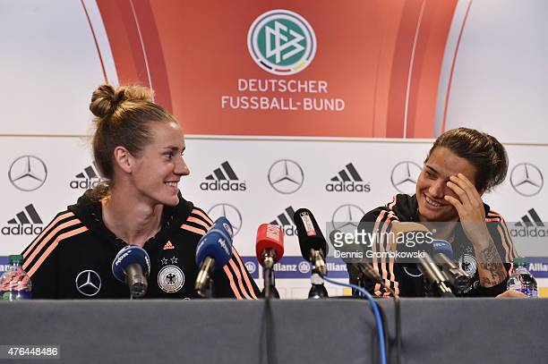 Dzsenifer Maroszan and Simone Laudehr of Germany face the media during a press conference at The Shaw Centre on June 9 2015 in Ottawa Canada