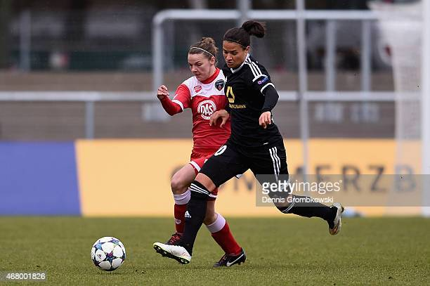 Dzsenifer Maroszan of 1 FFC Frankfurt and Loren Dykes of Bristol Academy WFC battle for the ball duirng the UEFA Women's Champions League quarter...