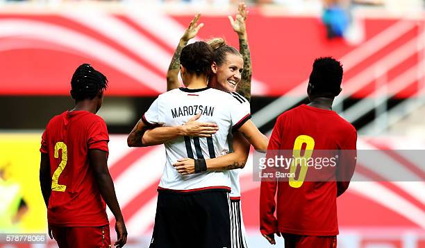 Dzsenifer Maroszan of Germany celebrates with Simone Laudehr of Germany after scoring her teams second goal during the women's international friendly...