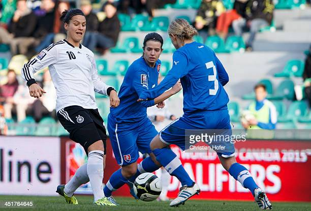 Dzsenifer Maroszan of Germany competes for the ball with Lucie Harsanyova and Lenka Mravikova of Slovakia during the FIFA Women's World Cup 2015...