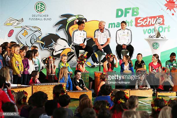 Dzsenifer Marozsan and Annike Krahn are intervewed during a visit at Adolf Delp Elementary School on April 8 2014 in Mannheim Germany