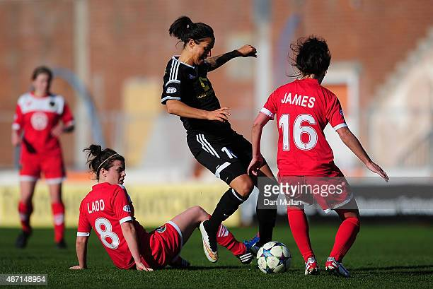 Dzsenifer Marozsan of FFC Frankfurt holds off Hayley Ladd and Angharad James of Bristol during the UEFA Womens Champions League Quarter Final match...