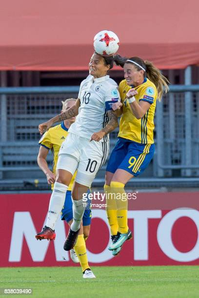 Dzsenifer Marozsan of Germany and Kosovare Asllani of Sweden battle for the ball l during the Group B match between Germany and Sweden during the...