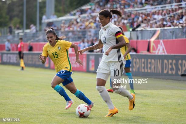 Dzsenifer Marozsan of Germany and Leticia Santos of Brazil battle for the ball during the Women's International Friendly match between Germany and...