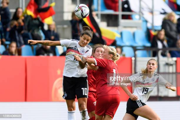 Dzsenifer Marozsan of Germany and Miljana Ivanovic of Serbia battle for the ball during the FIFA Women's World Cup 2023 Qualifier group H match...