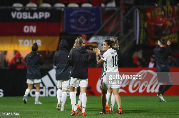 Dzsenifer Marozsan of Germany applauds the fans after the game was postponed due to heavy rain during the UEFA Women's Euro 2017 Quarter Final match...
