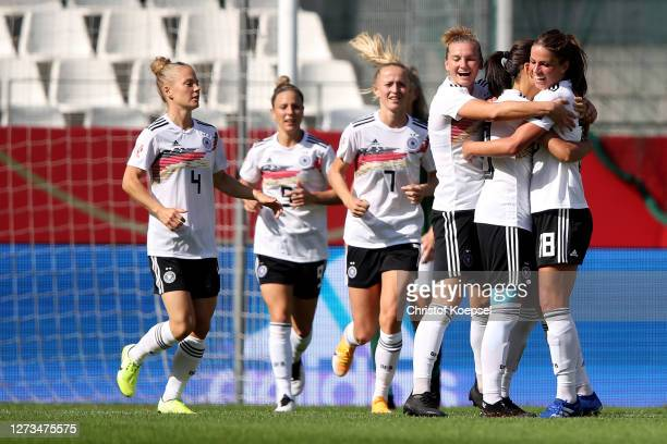 Dzsenifer Marozsan of Germany celebrates the second goal with Alexandra Popp and Melanie Leupolz of Germany during the UEFA Women's EURO 2022...