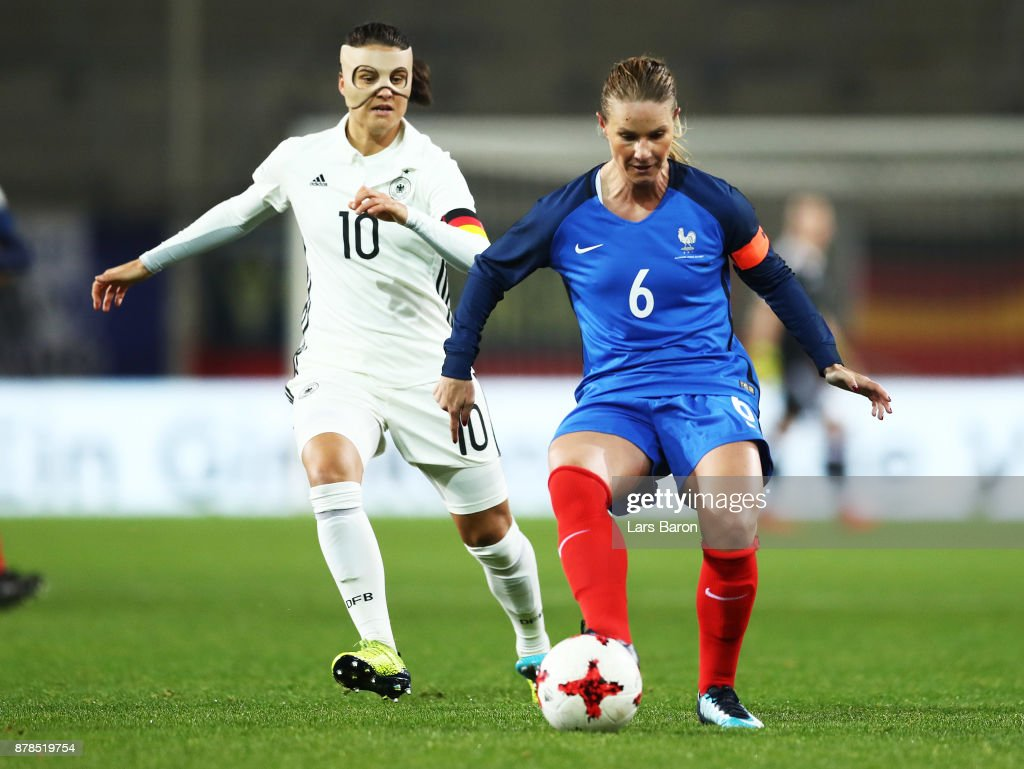 Dzsenifer Marozsan of Germany challenges Amandine Henry of France during the Germany v France Women's International Friendly match at Schueco Arena on November 24, 2017 in Bielefeld, Germany.