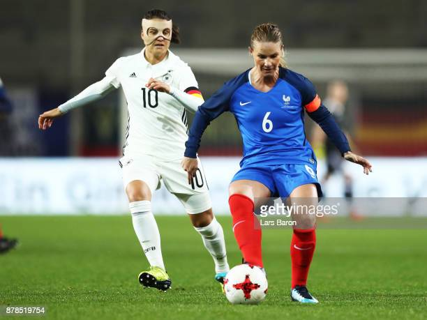 Dzsenifer Marozsan of Germany challenges Amandine Henry of France during the Germany v France Women's International Friendly match at Schueco Arena...