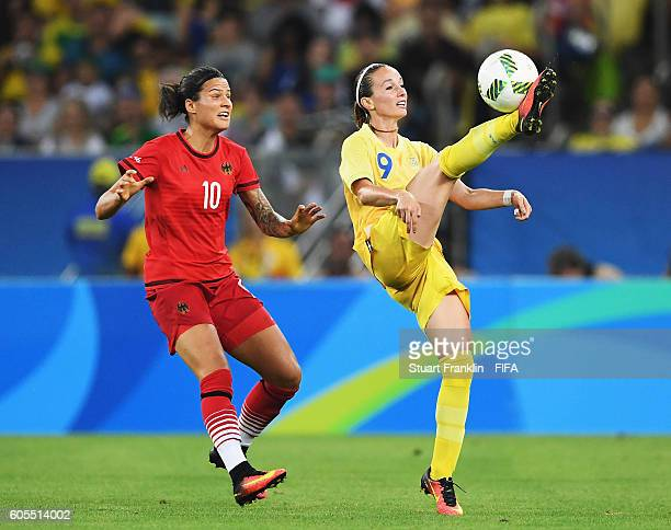 Dzsenifer Marozsan of Germany challenges Kosovare Asllani of Sweden during the Olympic Women's Football final between Sweden and Germany at Maracana...