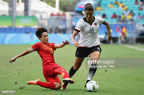 Dzsenifer Marozsan of Germany competes for the ball with Fengyue Pang of China during the Women's Football Quarter Final match between China and...