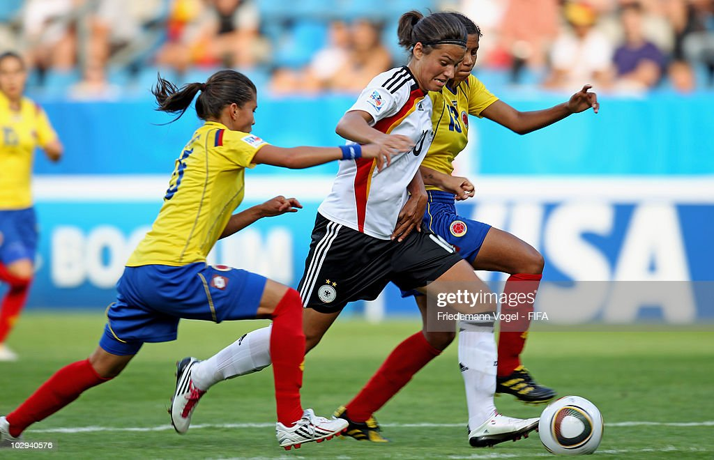 Dzsenifer Marozsan (C) of Germany in action with Natalia Ariza (L) and Yuliet Dominguez (R) of Colombia during the FIFA U20 Women's Worldd Cup Group A match between Germany and Colombia at the FIFA U-20 Women's World Cup stadium on July 16, 2010 in Bochum, Germany.