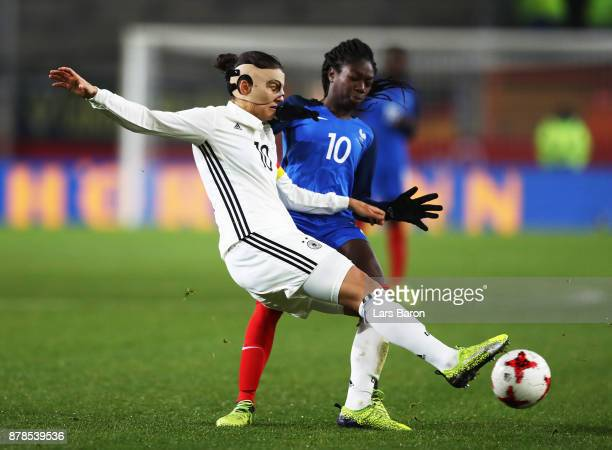 Dzsenifer Marozsan of Germany is challenged by Aminata Diallo of France during the Germany v France Women's International Friendly match at Schueco...