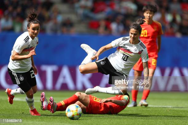 Dzsenifer Marozsan of Germany is challenged by Ruyin Tan of China during the 2019 FIFA Women's World Cup France group B match between Germany and...