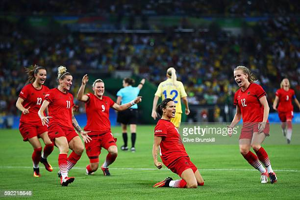Dzsenifer Marozsan of Germany is congratulated by team mates after scoring during the Women's Olympic Gold Medal match between Sweden and Germany at...