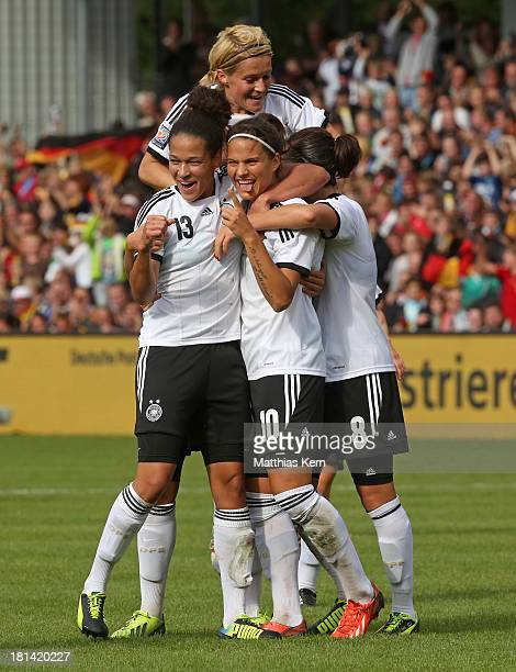 Dzsenifer Marozsan of Germany jubilates with team mates after scoring the third goal during the Women's World Championship qualification match...