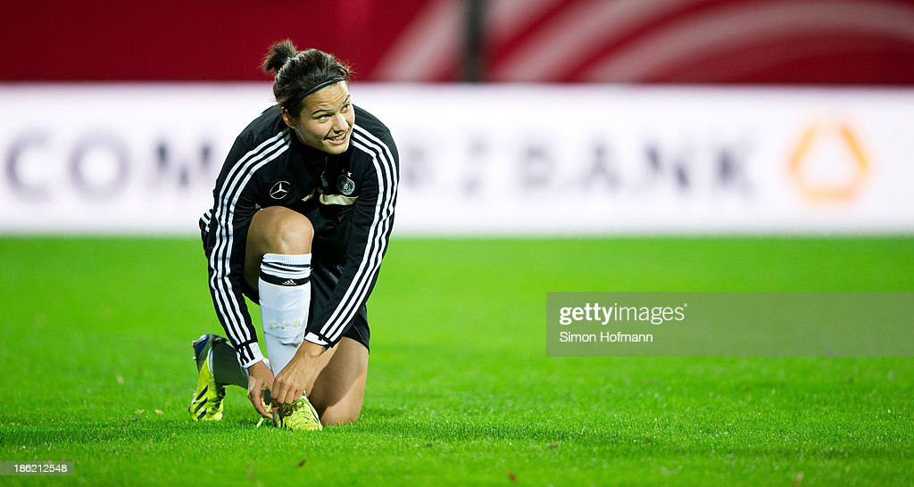 Dzsenifer Marozsan of Germany prepares for a Germany training session at Volksbank Stadion on October 29, 2013 in Frankfurt am Main, Germany.