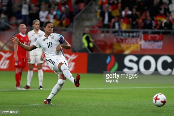 Dzsenifer Marozsan of Germany scores her sides second goal from the penalty spot during the Group B match between Russia and Germany during the UEFA...